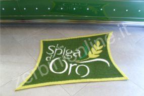 tappeto spiga d'oro, fondo verde con scritta bianca, contorno e spiga gialla, zerbini personalizzati, tappeti su misura, zerbino personalizzato, napoli, tappeti personalizzati.